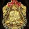 เหรียญเสมาหัวสิงห์ใหญ่ มวลสารชินบัญชรหน้าทองคำขอบทองคำลงยา 2 สี (แดง-น้ำเงิน)